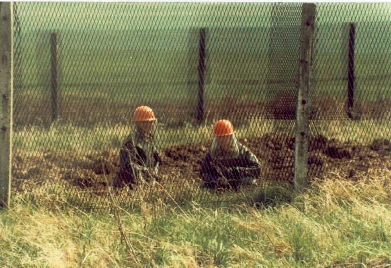 Scott Huffman - E Troop - border - 1985 - In the heavy underbrush, between two fences, East German Border Guard Engineers search for mines.