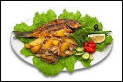 Запеченная рыба в духовке с картофелем и луком