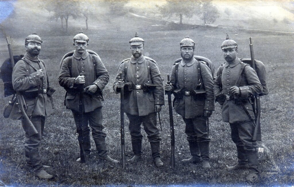 Nothing on reverse.Five Bavarian infantrymen - Landwehr or Landsturm, in full marching order.All five are wearing M1892 Überzug (covers) over their helmets devoid of any regimental number, dating this photograph sometime after October 1916.Two