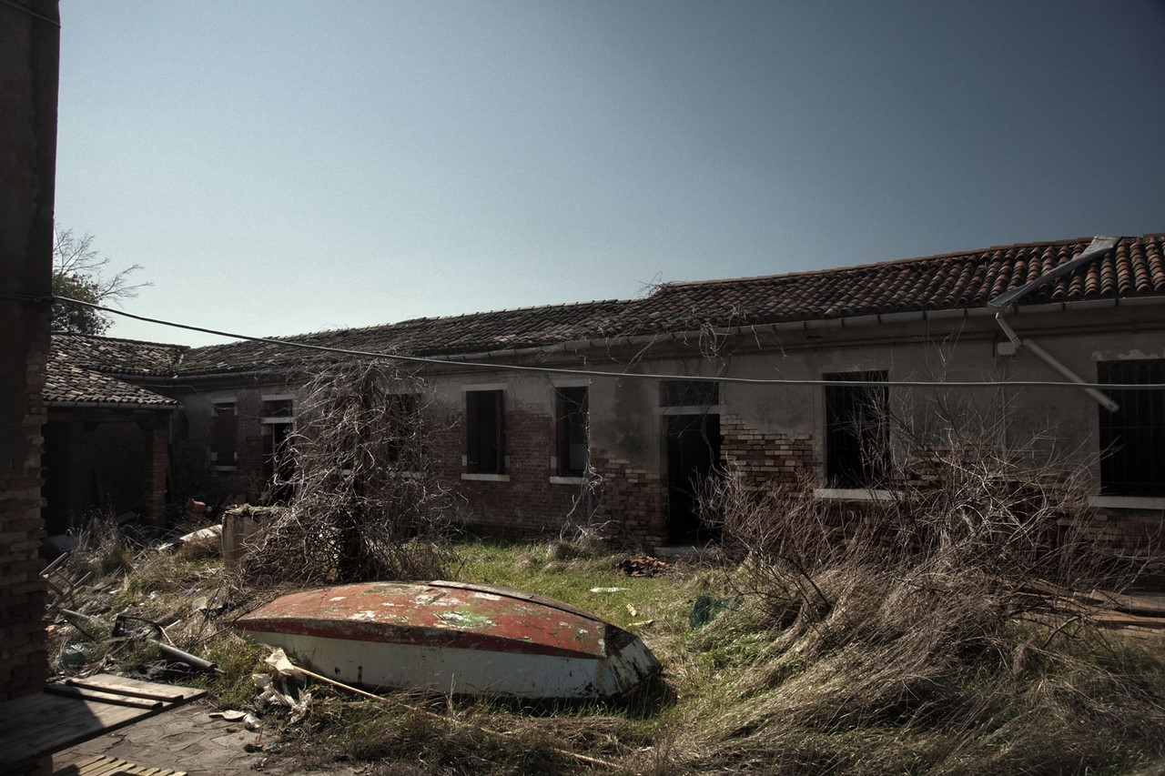 Abandomed boat on the Isola delle Grazie  Northen Lagoon Venice March 2013 Italy