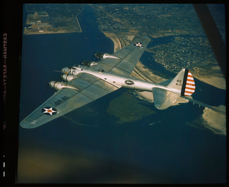 High 0ne-fourth left rear aerial view of US Army Air Forces Boeing XB-15 (aircraft code 41R-46) in flight near Mitchell Field, Long Island, New York, circa 1941; photo plane to be seen along the right edge of the image.