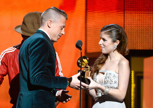 LOS ANGELES, CA - JANUARY 26: Rapper Macklemore (L) accepts the Best New Artist award from actress Anna Kendrick onstage during the 56th GRAMMY Awards at Staples Center on January 26, 2014 in Los Angeles, California. (Photo by Kevork Djansezian/Getty I