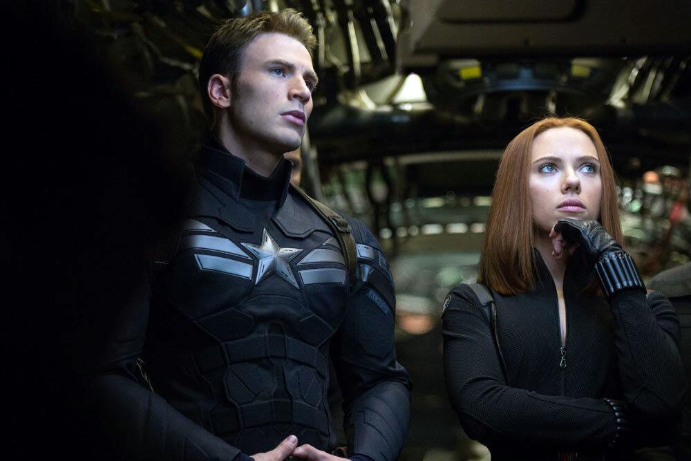 """Marvel's Captain America: The Winter Soldier""..L to R: Black Widow/Natasha Romanoff (Scarlett Johansson) & Captain America/Steve Rogers (Chris Evans)..Ph: Zade Rosenthal..© 2014 Marvel.  All Rights Reserved."