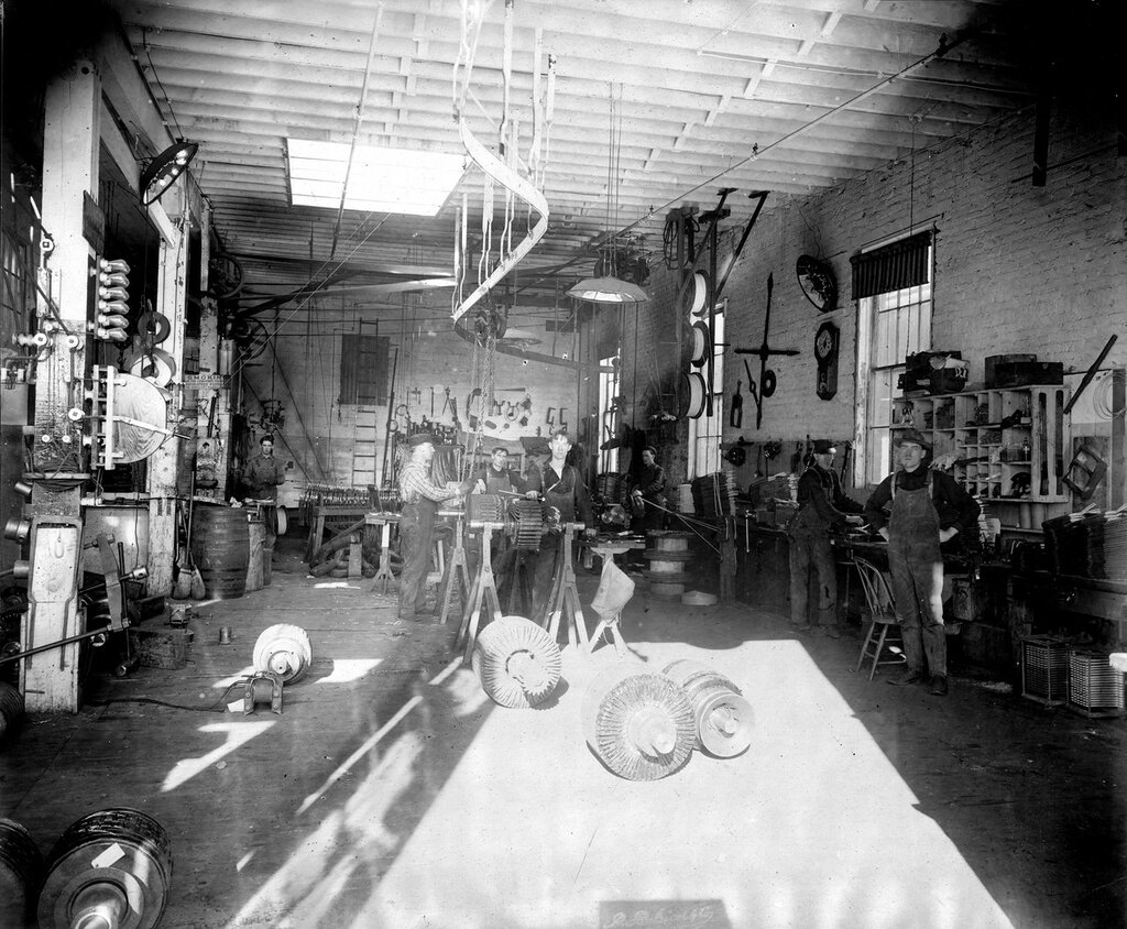 """Denver Tramway Company machine shop in Denver, Colorado. Sign reads """"Smoking In The Company's Premises Absolutely Forbidden, The Denver City Tramway Company"""". between 1900 and 1905"""