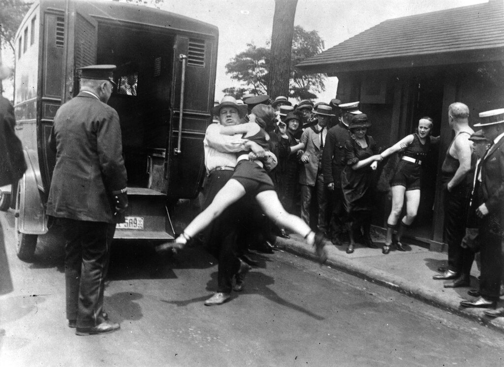 Women in Chicago being arrested for wearing one piece bathing suits and showing a little leg