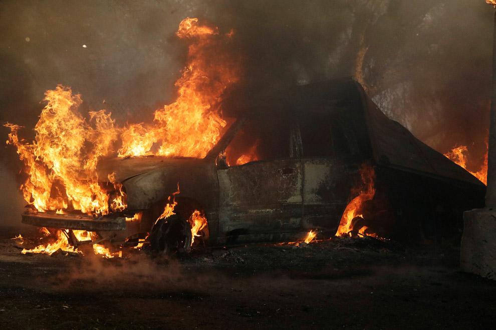 23. Лесные пожары и их последствия в округе Вентура, Калифорния, 5 декабря 2017. (Фото Noah Berger):