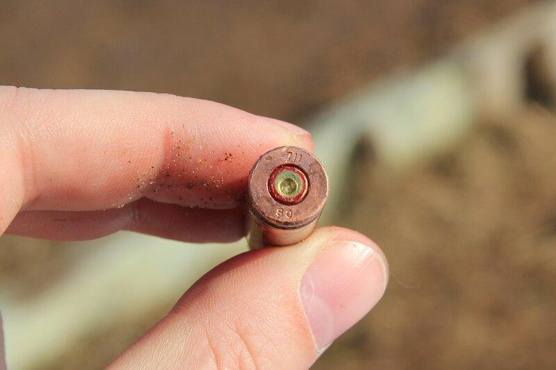 Стреляная медная гильза с цифрами 711 и 80