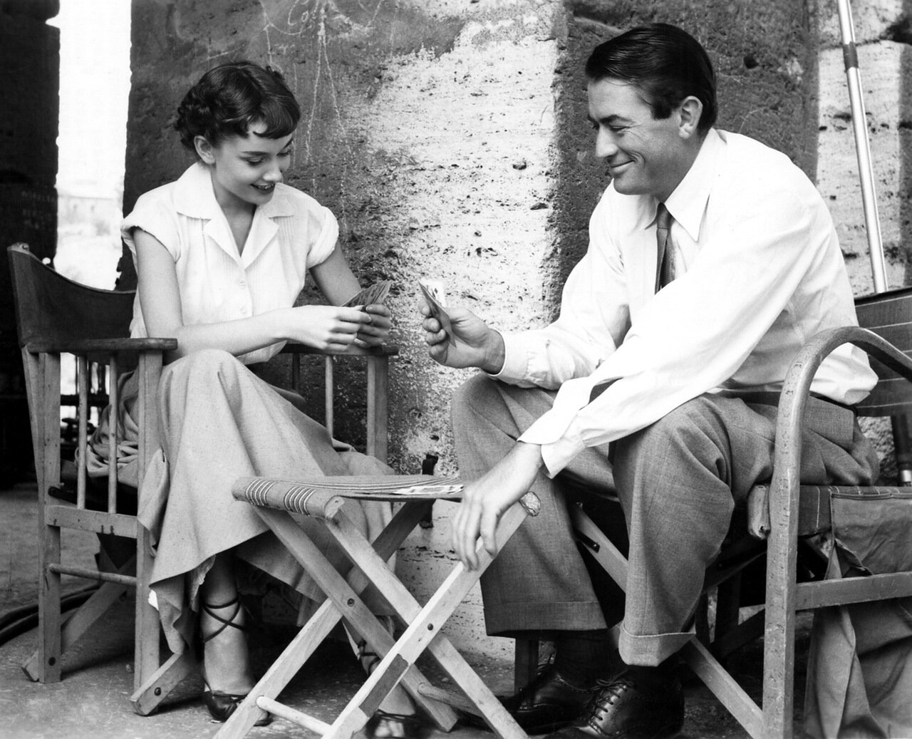 Audrey Hepburn and Gregory Peck relax in Rome during a break from shooting the 1953 film Roman Holiday