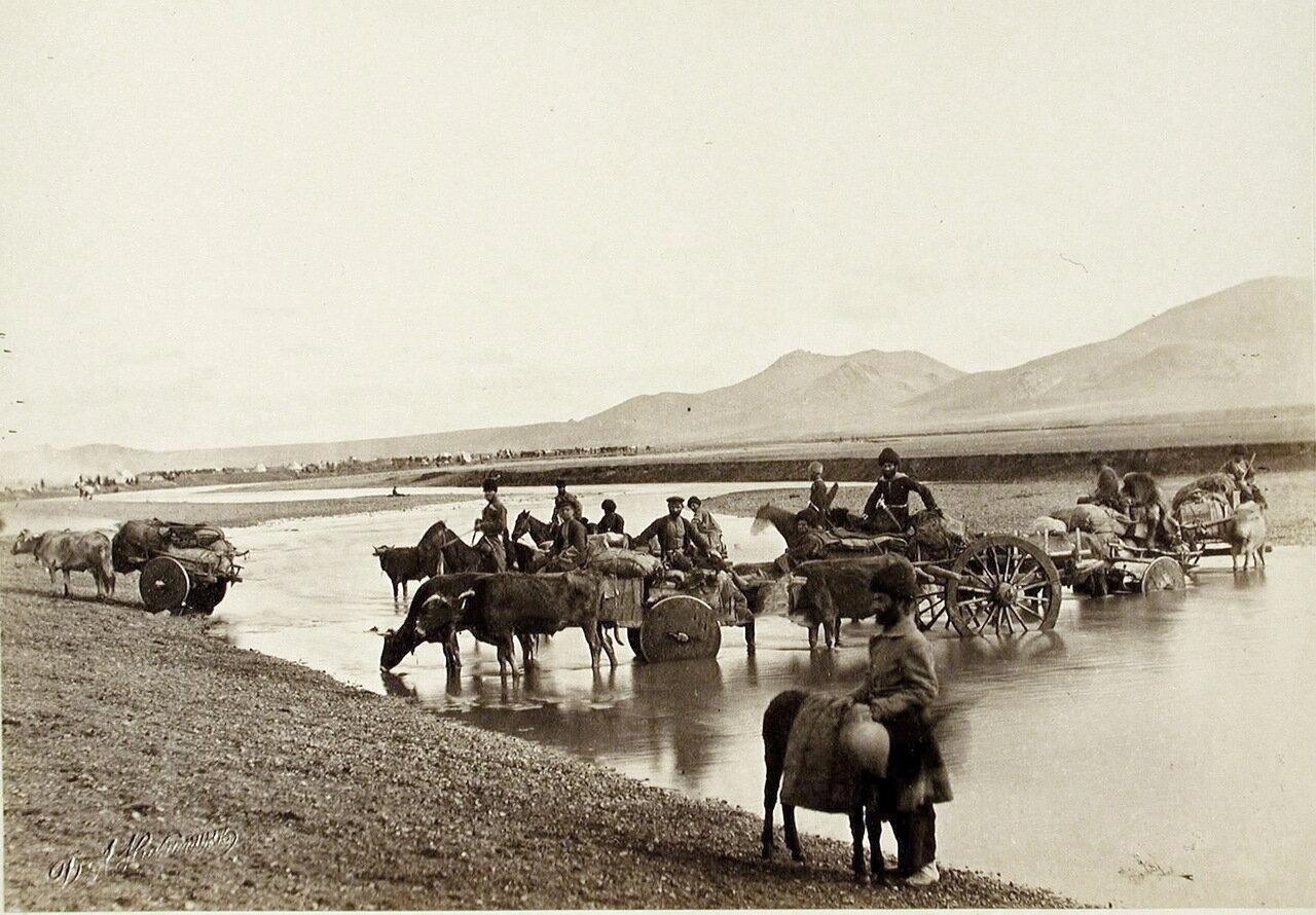 Обоз переправляется через реку вблизи селения Большие Тикмы