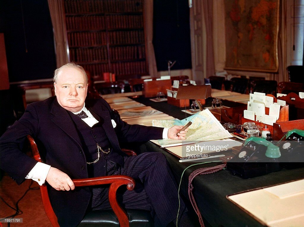 London, England, March 1945, British Prime Minister, Winston Churchill (1874-1965) at his desk.jpg