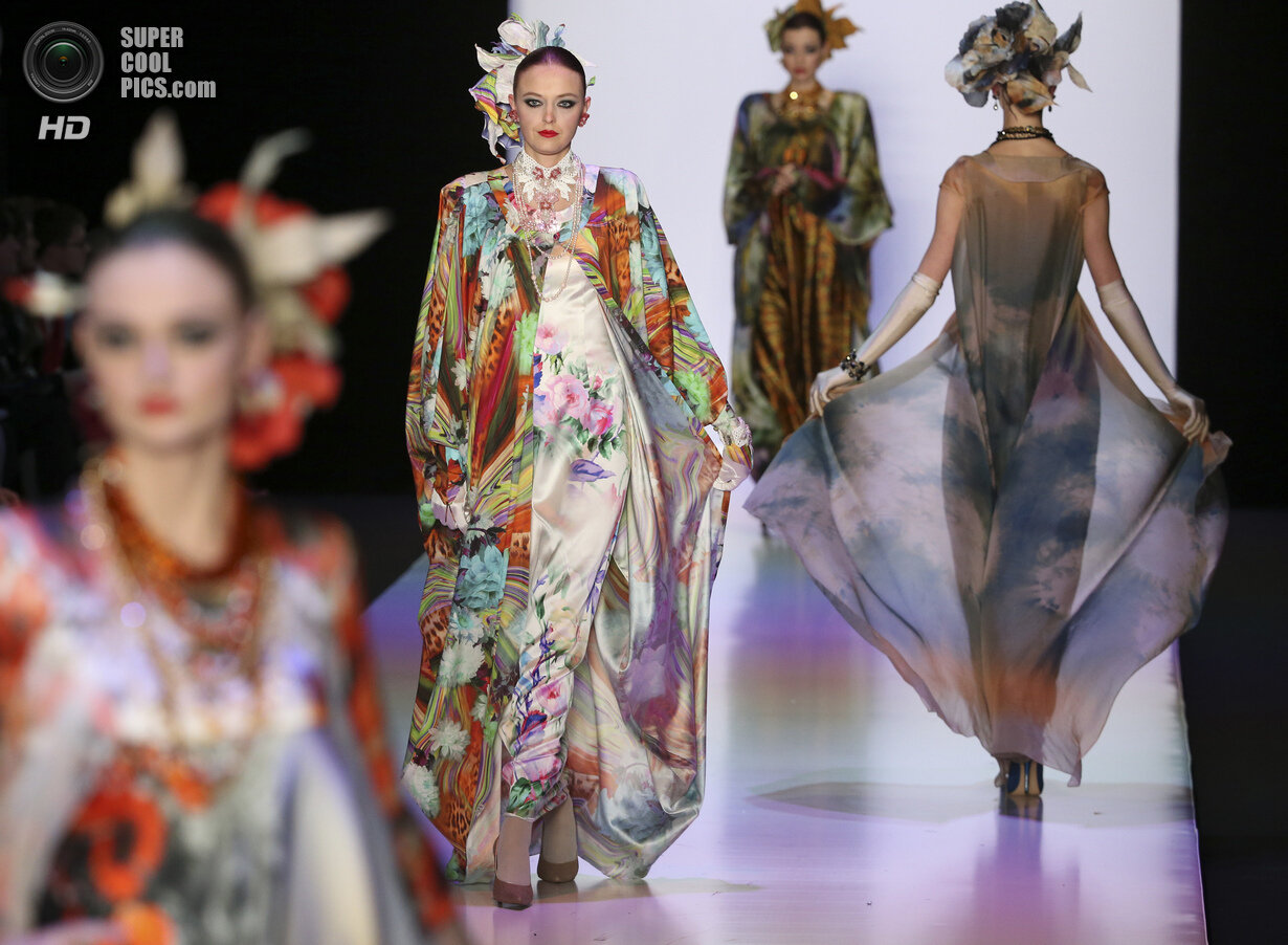 Models present creations by Russian designer Slava Zaitsev at the Mercedes-Benz Fashion Week Russia in Moscow