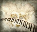Fondo per musica con maschera veneziana e tasiera di pianoforte
