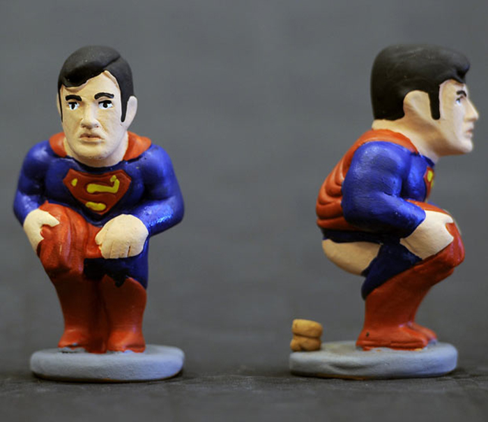 Ceramic figurines, known locally as caganers, of cartoon character Superman are displayed on November 8, 2011. Statuettes of well-known people defecating are a strong Christmas tradition in Catalonia, dating back to the 18th century as Catalonians hide ca