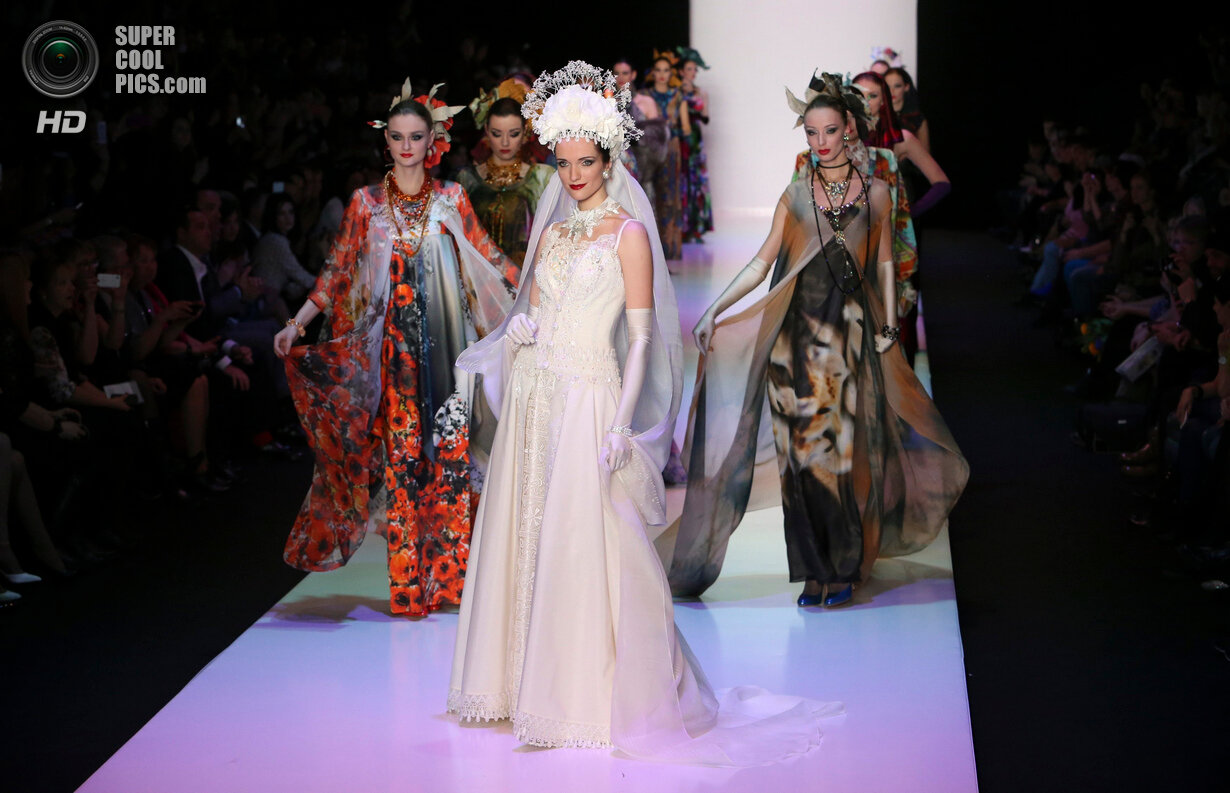Models present creations by Russian designer Zaitsev at the Mercedes-Benz Fashion Week Russia in Moscow