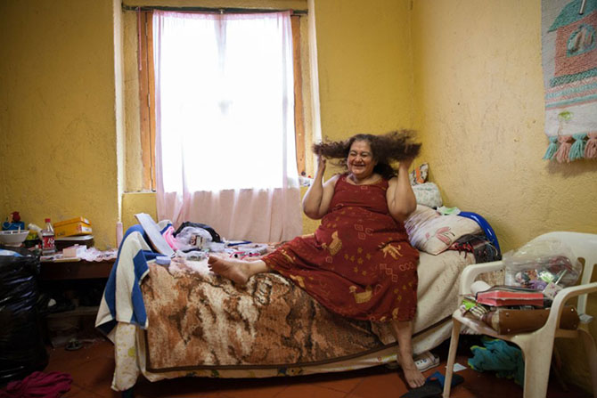 "Mexico City, 2013, Portrait of María Isabel, a resident at Casa Xochiquetzal, in her bedroom. The former sex worker, who grew up in Michoacán, ran away from home at the age of nine after a year in which her father ""used her."" When she got to the Mexico Ci"