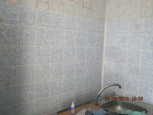 Отделали пластиком стены над мойкой в кухне