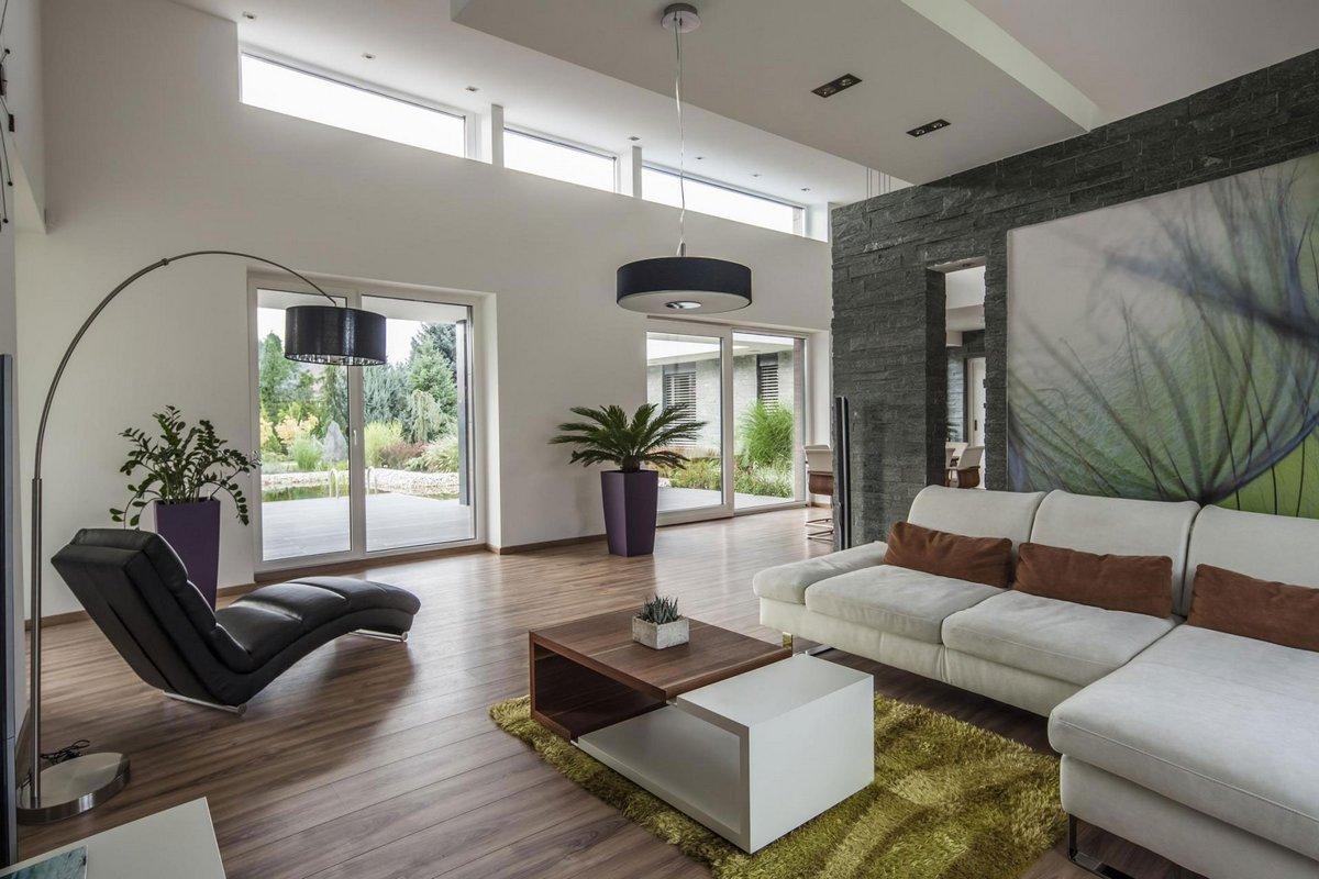 TOTH PROJECT, фасад частного дома, бассейн-озеро в частном доме, частный дом в Венгрии, современный дизайн интерьера, камень в дизайне интерьера фото