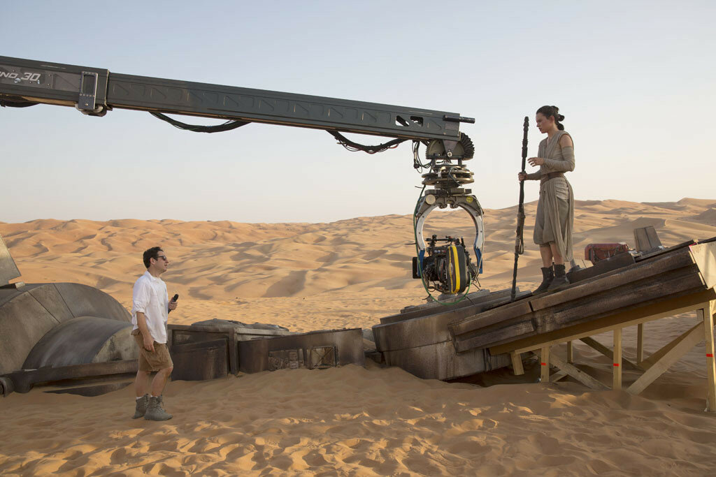 Star Wars: The Force Awakens..L to R: Director J.J. Abrams w/ actress Daisy Ridley (Rey) on set...Ph: David James..©Lucasfilm 2015