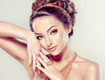 Model with Coral makeup and manicure