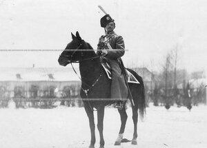 Казак сибирской полусотни 3-ей сотни полка в зимней парадной форме на коне.