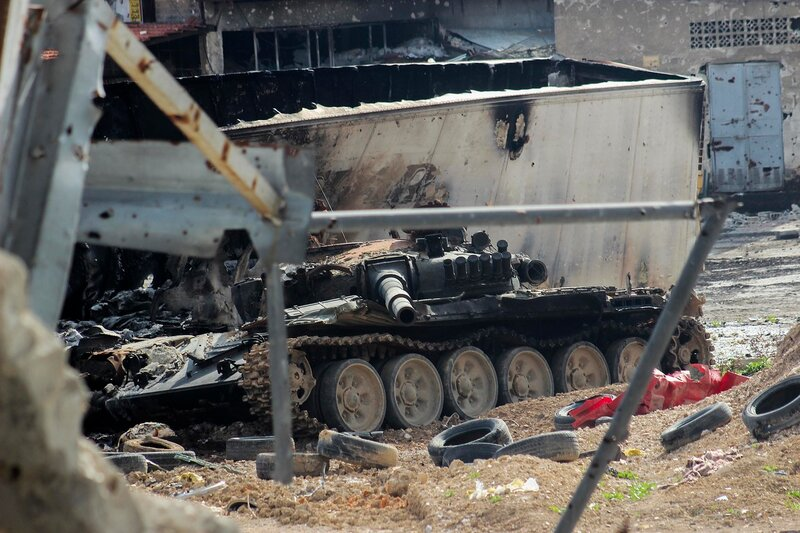 A damaged tank is pictured on one of the battlefronts in Jobar, a suburb of Damascus