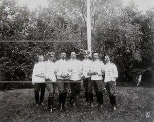 Группа офицеров полка в саду по окончании маневров.