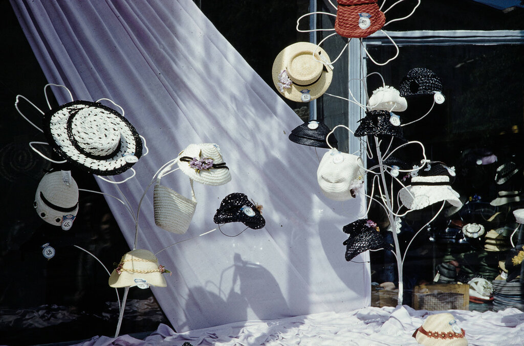 Russia, hat display in store window in Moscow