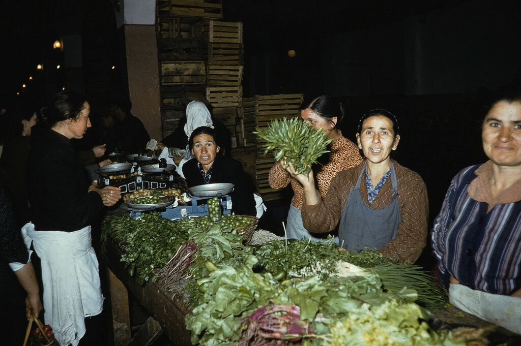 Russia, women selling farm goods at market