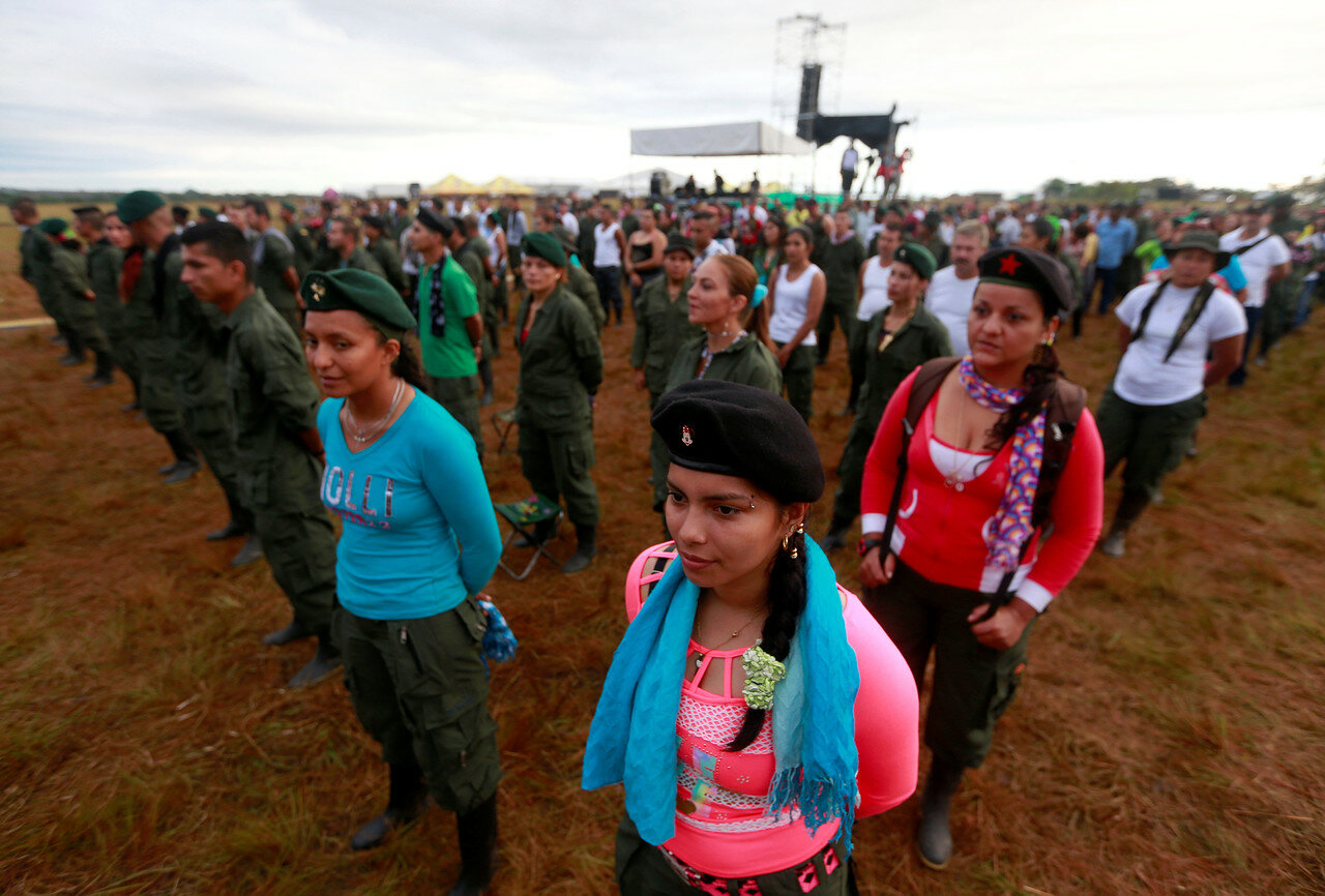 Fighters from Revolutionary Armed Forces of Colombia (FARC), stand in line during opening of ceremony congress at camp where they prepare for ratifying a peace deal with government, near El Diamante in Yari Plains, Colombia