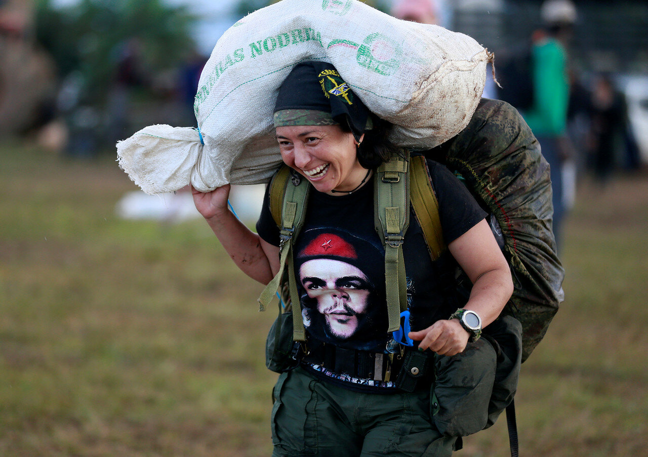 A fighter from FARC arriving at the camp where they prepare for an upcoming congress ratifying a peace deal with the government near El Diamante in Yari Plains, Colombia