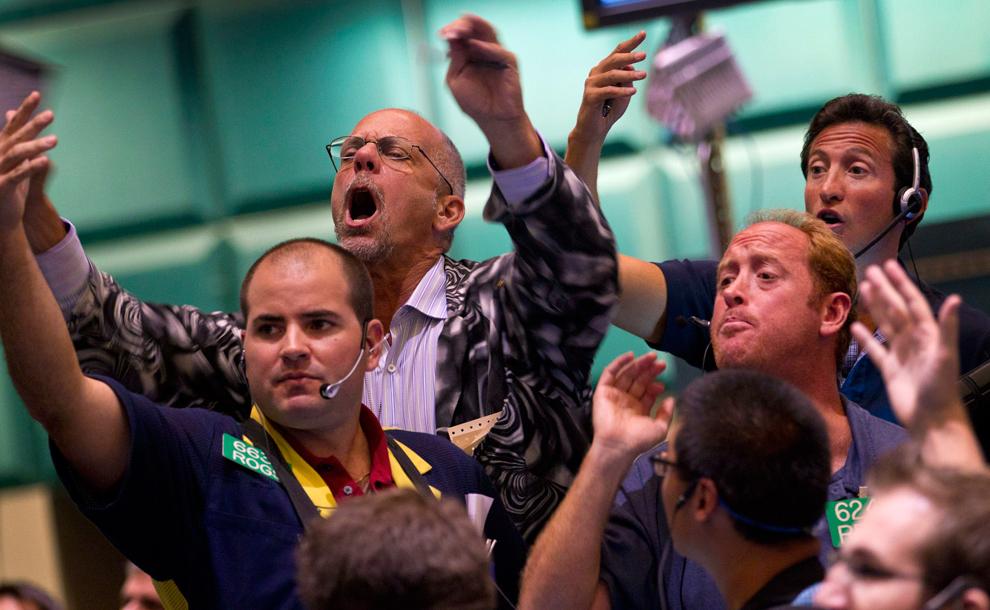 24. Трейдеры торгуют опционами на золото и серебро на Нью-Йоркской товарной бирже в Нью-Йорке, 24 ав