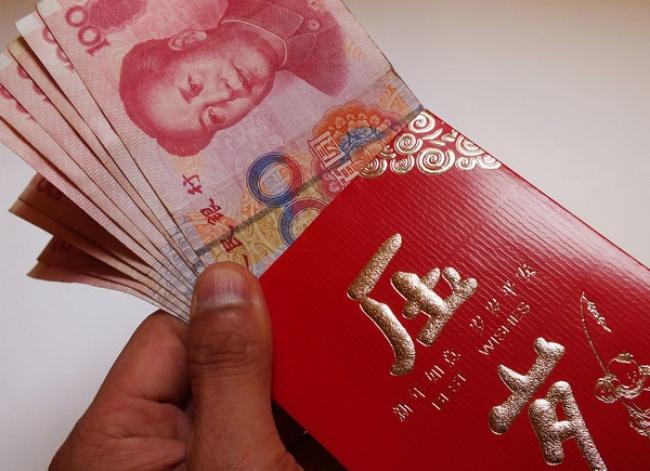 © helpgoabroad  Впервый день нового года ходят друг кдругу вгости. Китайцы дарят практичные
