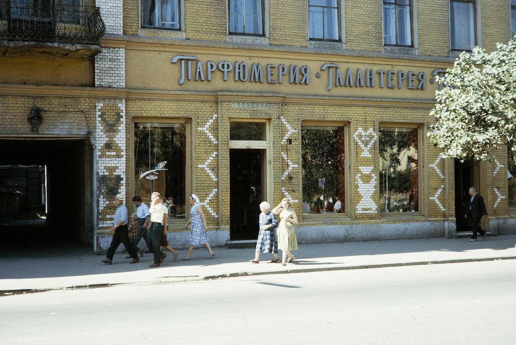 Russia, pedestrians walking past perfume shop Irkutsk