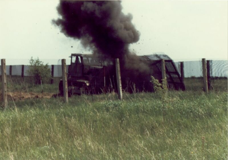Scott Huffman - E Troop - border - 1985 - An East German dozer sets off a mine as they clear the area between the fences.
