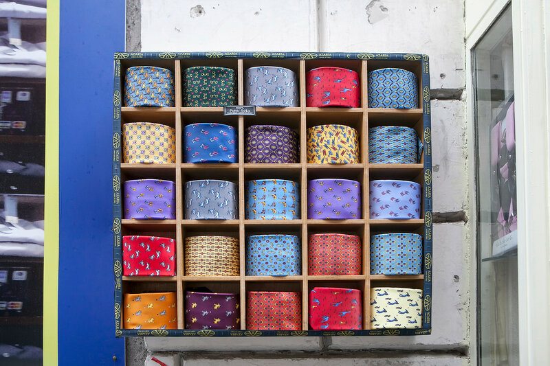 Multi-colored ties with a pattern are sold in the boutique