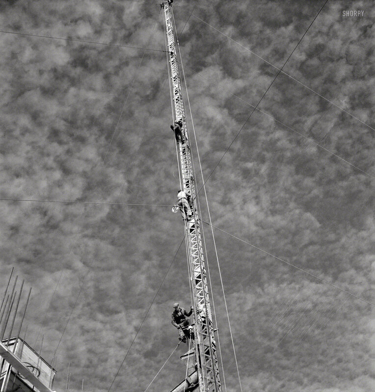 November 1942. Columbia Steel Company at Geneva, Utah. Rigging a pipe-setting derrick for a new mill under construction which will make important additions to the vast amounts of steel needed for the war effort