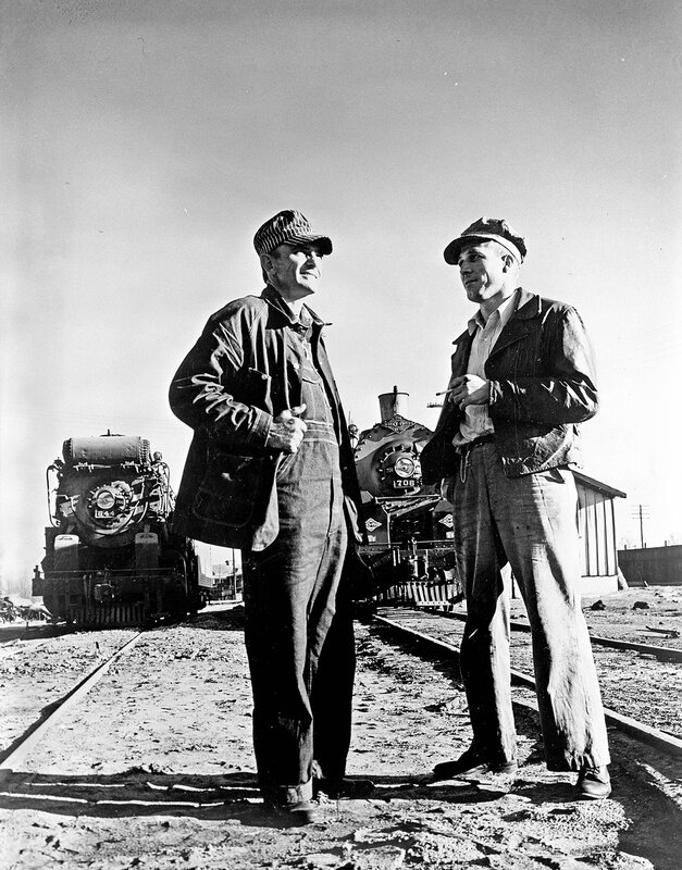 Homer Parrish and Another Man Standing in Front of Locomotives 644 and 706, Texas & Pacific Railway Company, 1946
