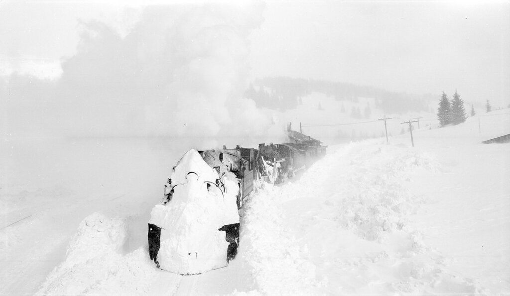 Plowing out house track 483 working. Denver and Rio Grande Western train with two locomotives near Cumbres (Rio Arriba County), New Mexico. 1949 January 1