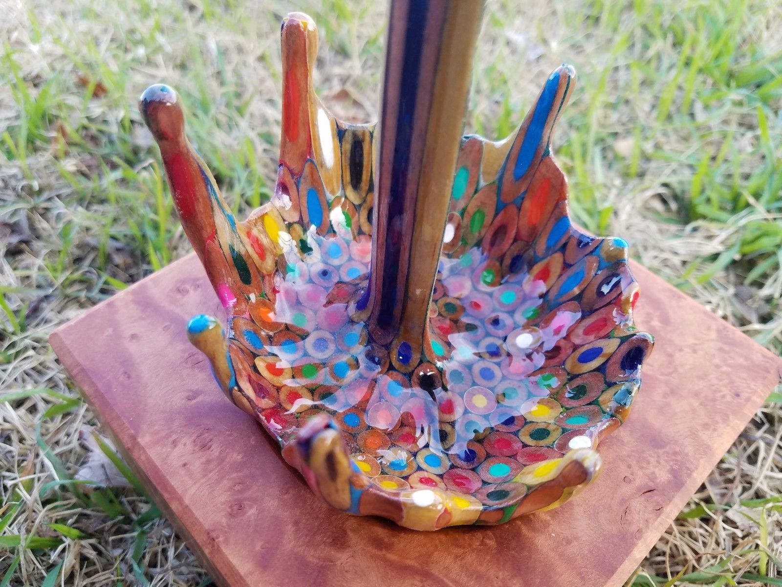 A Floating Coffee Cup Pours a Rainbow of Liquid Pencils
