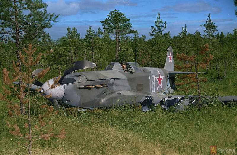 A Finnish soldier inside the cockpit of a Yak 9M crash landed by two Soviet defectors.jpg