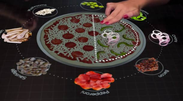 An interactive table to create your Pizza at Pizza Hut